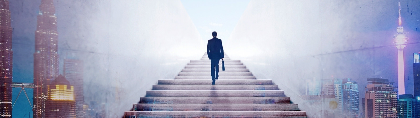 Businessman walking up stairs to the clouds